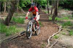 Man Biking on Trail
